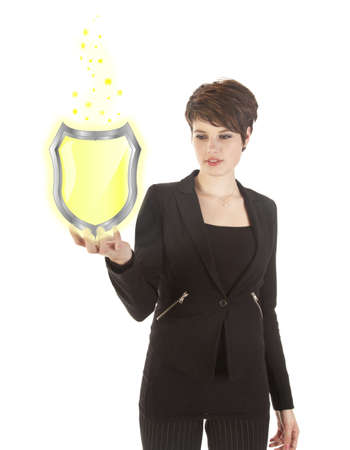 young woman holding shiny yellow shield isolated on white background photo