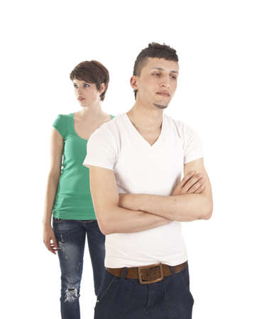 Young man and woman arguing isolated on white background photo