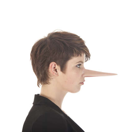 long nose: Young woman making a lie with long nose isolated on white background Stock Photo