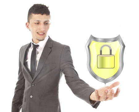 young man holding shiny yellow shield with lock isolated on white background photo