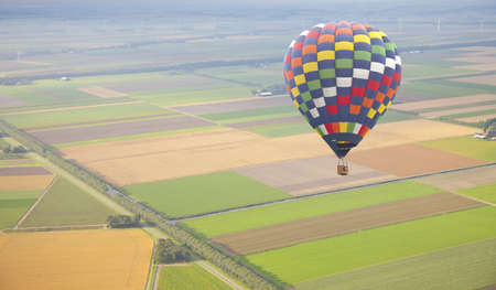 Hot air balloon with green Dutch landscape from above