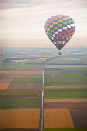 Hot air balloon with green Dutch landscape from above photo