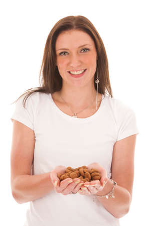 pepernoten: Young woman holding typical Dutch candy pepernoten isolated on white background