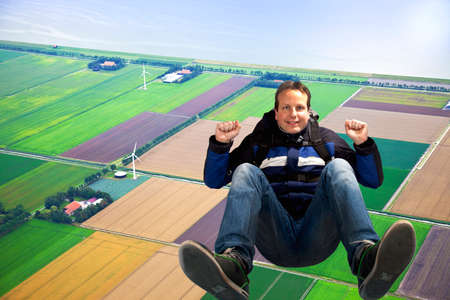 Man jumping out of plane with parachute photo