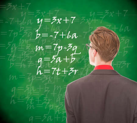 Young student looking at chalkboard with mathematics photo