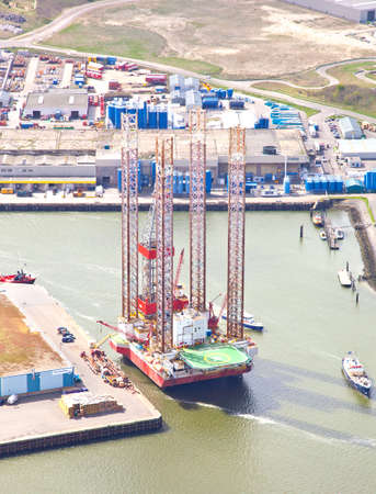 IJMUIDEN, THE NETHERLANDS - APRIL 15: Aerial view on offshore island in harbour of IJmuiden, The Netherlands at April 15 2014. Offshore islands are essential in gaining oil and gas for worldwide usage