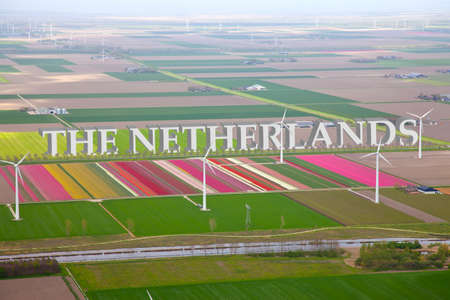 Dutch colourful flower field from above with Netherlands 3d Text photo