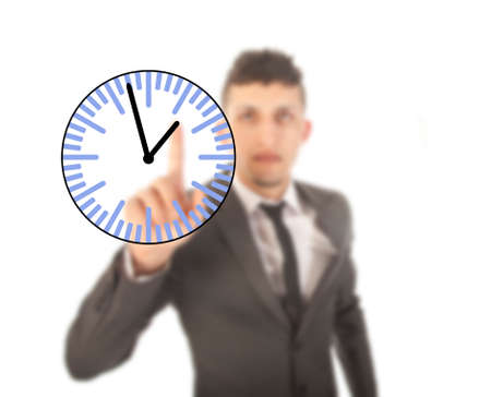 Young businessman with clock isolated on white background photo