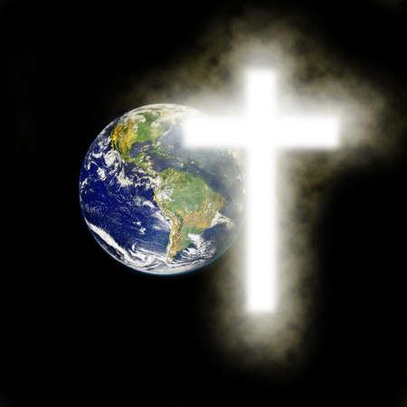 cruz religiosa: Tierra con la cruz religiosa con el fondo negro.