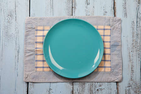 plate setting: Empty plate on light blue wooden background Stock Photo