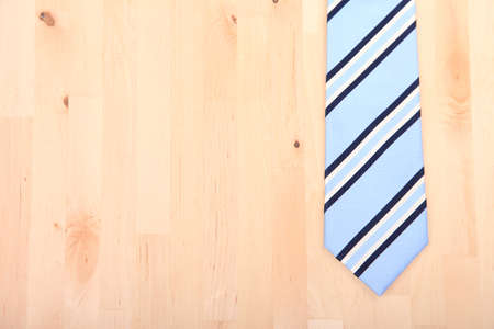 tie: Striped business tie on wooden background
