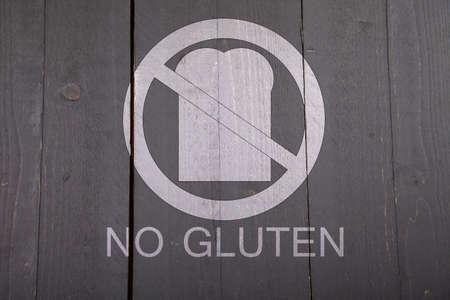 hypoallergenic: Gluten free bread sign on black wooden background