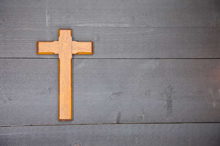 easter cross: Wooden easter cross on black wooden background Stock Photo