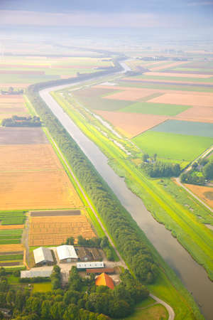 dutch: Dutch landscape with straight canal from above Stock Photo