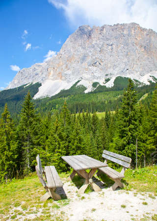 picknick: View at picknick table near Ehrwalder Almsee with mountain landscape, Tirol, Austria Stock Photo