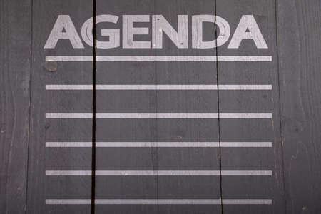 agenda: Agenda list on black wooden background Stock Photo