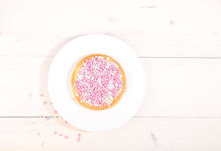 newborn rat: Traditional Dutch birth celebration biscuit with pink muisjes on wooden background Stock Photo
