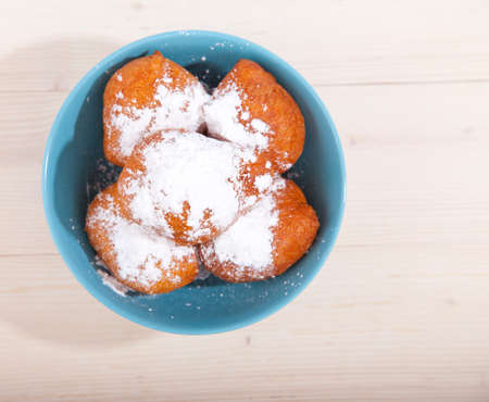 Traditional Dutch oliebollen on wooden background
