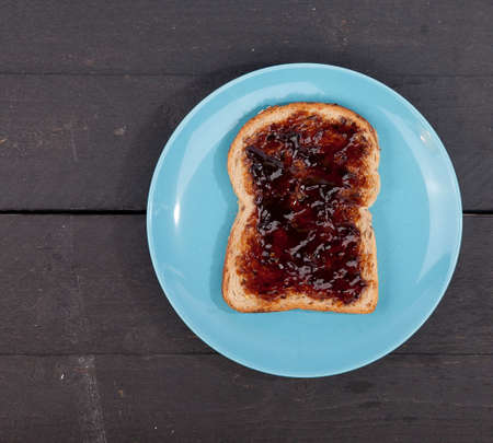 dutch typical: Typical Dutch apple syrup called Appelstroop on bread on wooden background