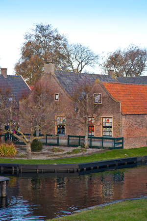View at very old houses with canal in Enkhuizen, The Netherlands Stock Photo