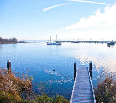 View at jetty with boat and lake in Enkhuizen, The Netherlands