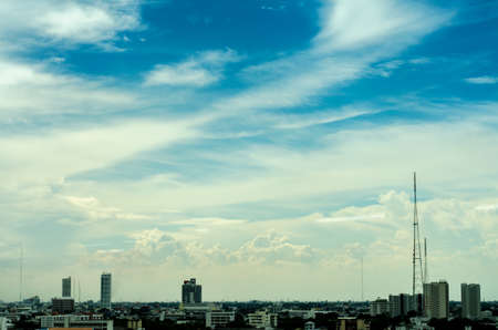 white clouds: blue sky background with clouds over the city