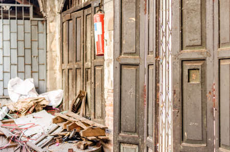 trashed: Old furniture and wood wall that is turned upside down in a house  full of trash Stock Photo