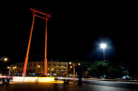 Giant Swing in Bangkok background wat Sutadhtepvararam. photo