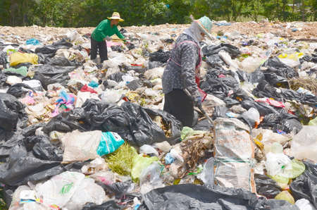refuse: Employees and Scavengers are processing waste in Dump site at Ratchaburee City Thailand on May 6, 2012. People searching for refuse to recycle or resell Editorial