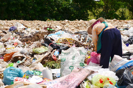 pile engine: Employees and Scavengers are processing waste in Dump site at Ratchaburee City Thailand on May 6, 2012. People searching for refuse to recycle or resell Editorial