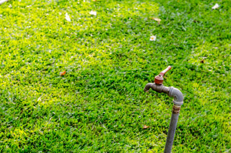 close up old rusty water tap in garden photo
