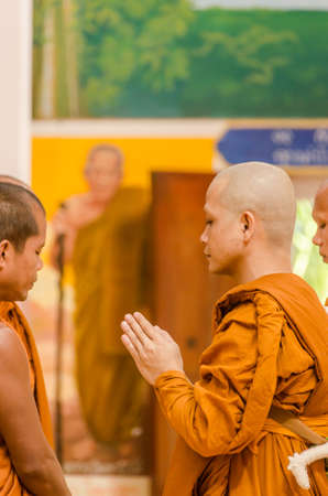 make belief: SAKONNAKHON,THAILAND December 23: Newly ordained Buddhist monk pray with priest procession. Newly ordained Buddhist monks have a ritual in the temple procession in December 23, 2012 Editorial