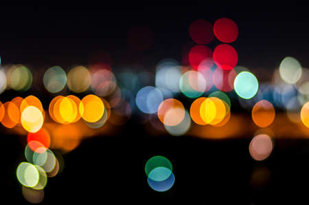 Urban city night light bokeh , defocused blur background Banco de Imagens