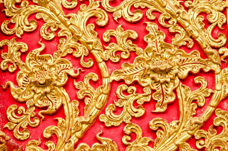 thai decor: Texture of Stucco golden color tree at Wat Prathat Lampang Luang Temple Lampang Thailand
