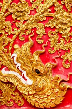 cartage: Texture of Stucco golden color tree at Wat Prathat Lampang Luang Temple Lampang Thailand