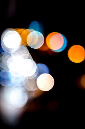semitransparent: Colorful defocused bokeh lights background. Festive background with natural bokeh. Abstract blur background.