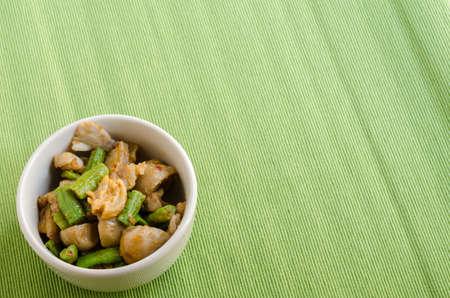 long bean: Fried spices crispy skin pork with mushroom and Yard Long bean, Thai food menu Stock Photo