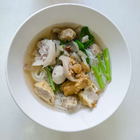pigtail: Thai noodle with Pig-tail in white table