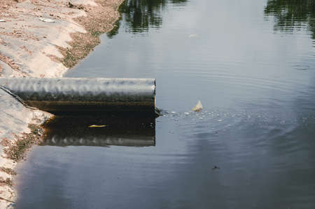 landfill site: wastewater pipe in landfill site in Thailand