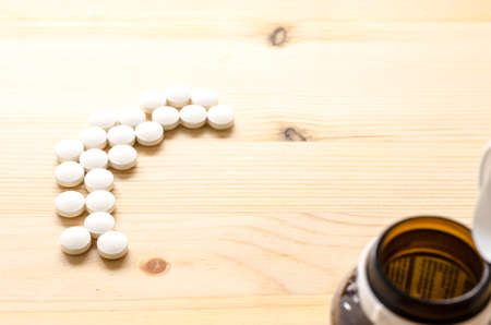 medicine tablets on wood background