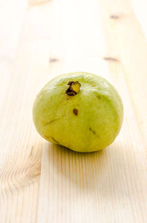 dietetical: The tropical fruit high vitamin c, fresh guavas on wood background