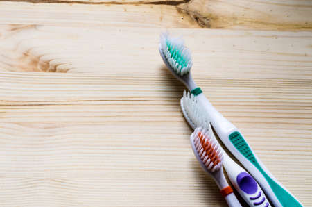 cinematic: Old toothbrush on wooden background. Cinematic tone