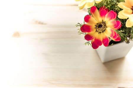 life style: Flowers and pot on the office desk. Vintage tone Stock Photo