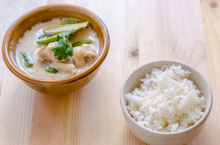 sour grass: Thai Chicken Soup in Coconut Milk Tom Kha Gai with rice on wooden background, thai food.