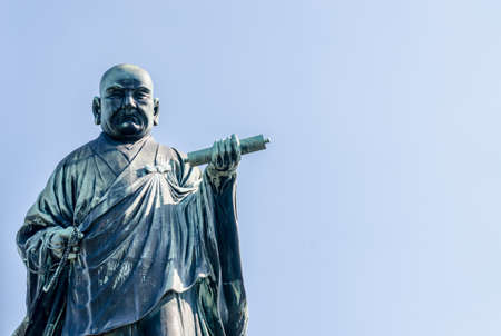 the founder: FUKUOKA, JAPAN - NOVEMBER 6: The bronze statue of Nichiren Shonin a founder of Nichiren School, a school of Buddhism in japan at NOVEMBER 6, 2015 in FUKUOKA PREFECTURE JAPAN