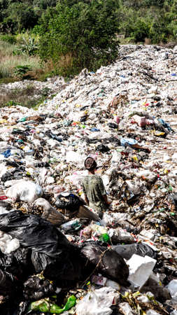 waste disposal: BUENGKHAN PROVINCE, THAILAND - JANUARY 13: Man working in Municipal waste disposal open dump process.  Dump site at Buengkhan Province on JANUARY 13 , 2016 in BUENGKHAN PROVINCE THAILAND