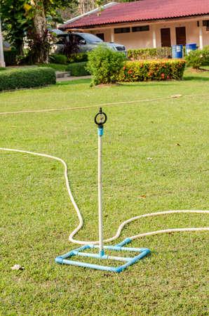 water sprinkler: Lawn water sprinkler spay water over green grass