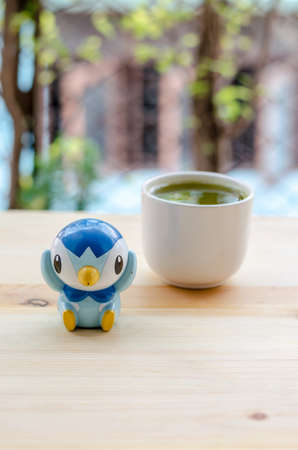 Plasticine penguin and matcha green tea in relaxing time