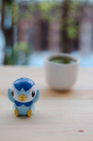 oriental medicine: Plasticine penguin and matcha green tea in relaxing time