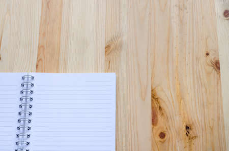paper note: Note book paper on wooden background